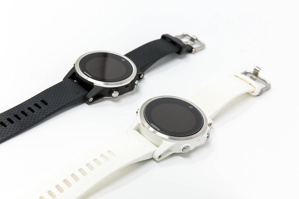 Garmin Fenix 5S Smartwatches in black and white on white background