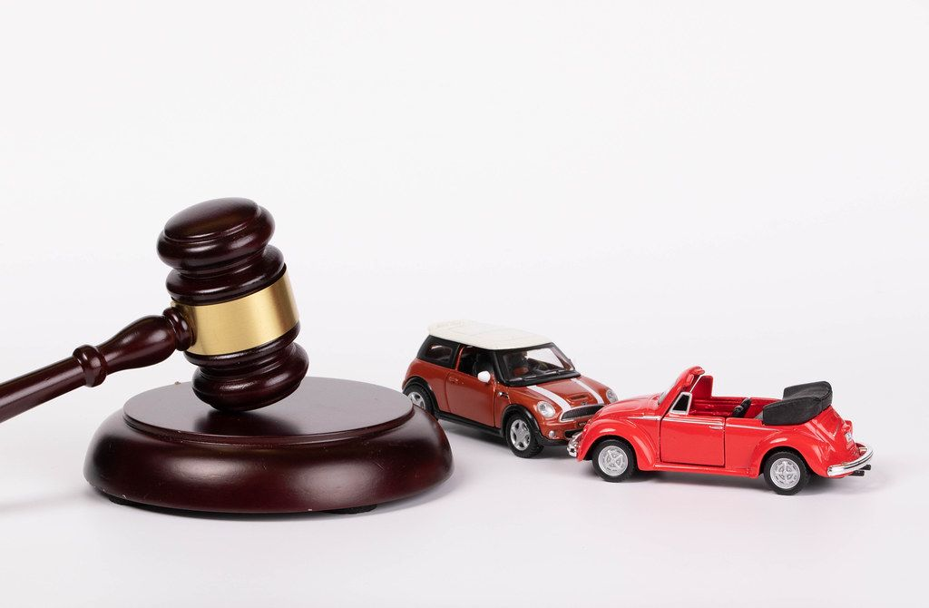 Gavel and two toy cars