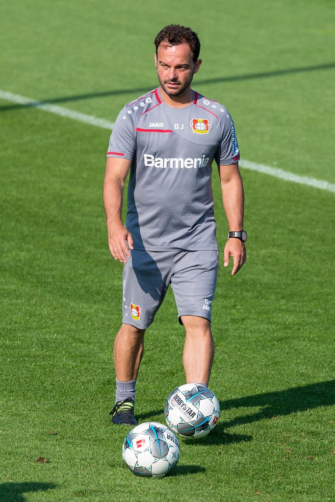 German Athletics coach Daniel Jouvin in grey jersey with soccer balls during soccer training of Bayer 04 Leverkusen