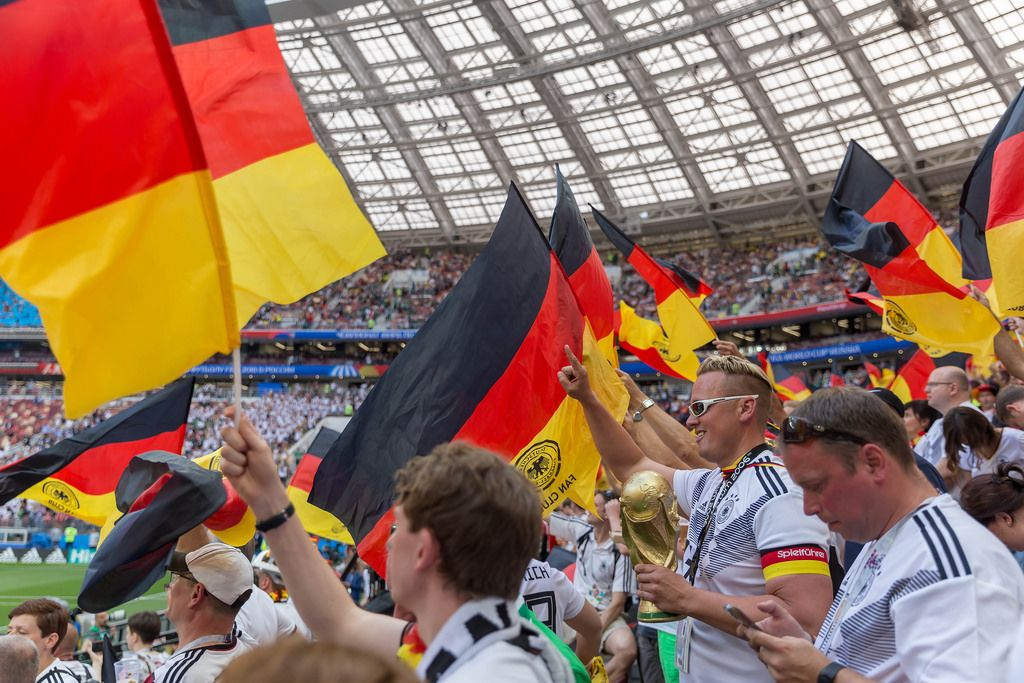 German soccer fans with flags and trophies