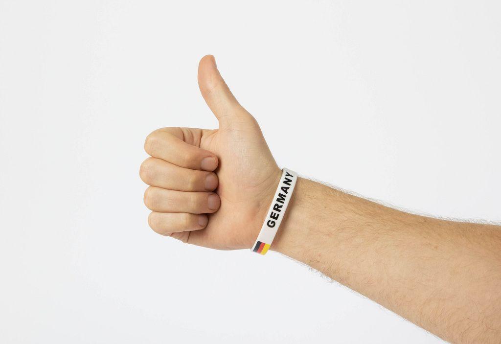 German sports fan showing thumbs up
