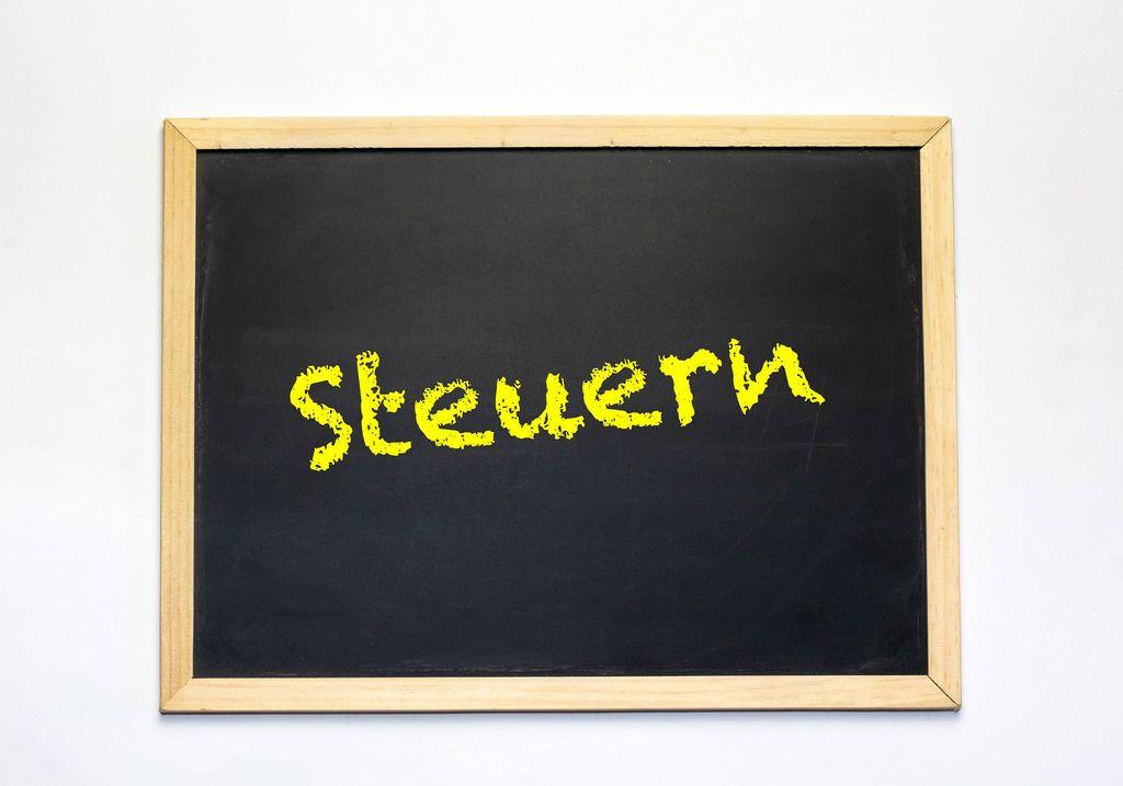 German word Steuern on blackboard