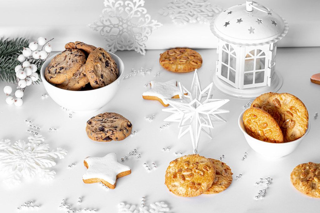 Ginger, chocolate and peanut cookies on a light Christmas background