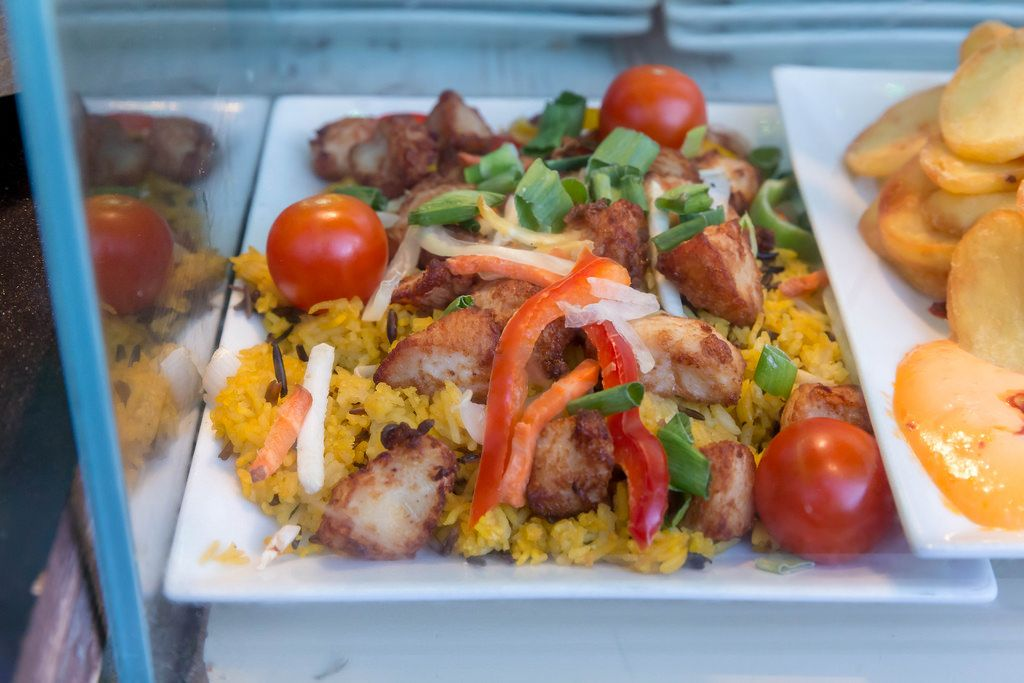 Ginger honey chicken with yellow rice, peppers and cherry tomatoes