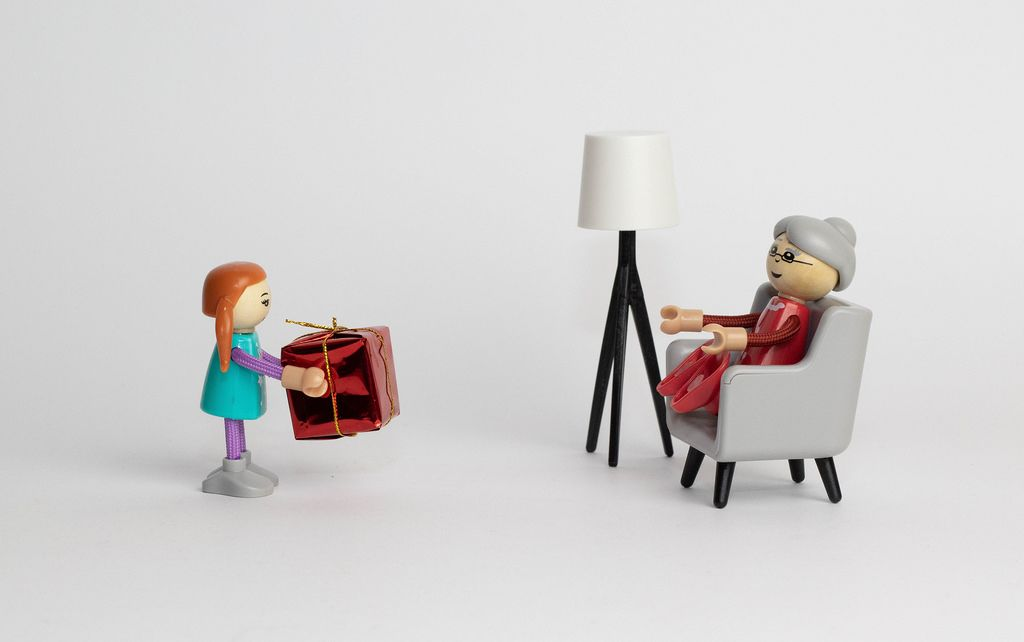 Girl giving present to grandmother