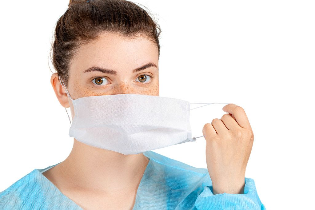 Girl with a protective medical mask. Disease prevention, health Care