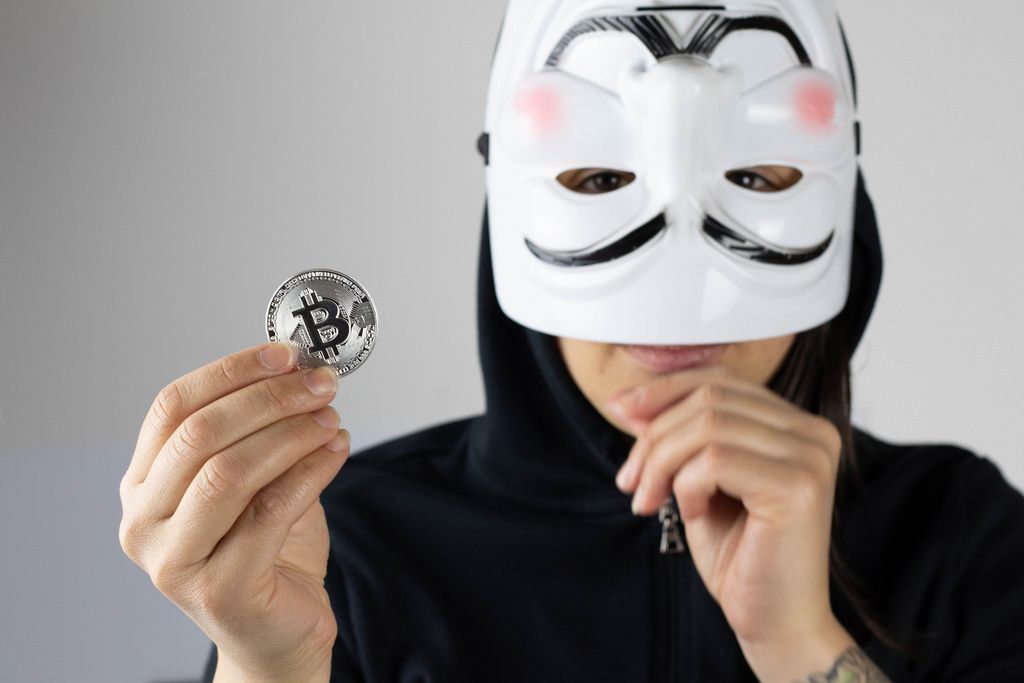 Girl with white mask holding Bitcoin
