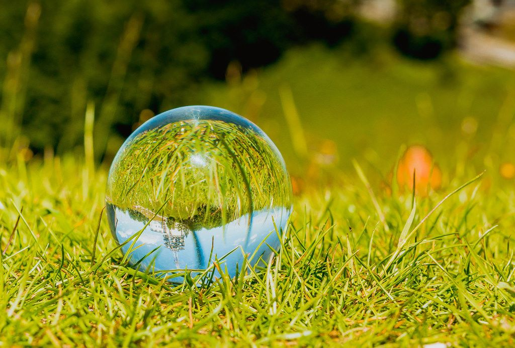 Glass ball laying in grass
