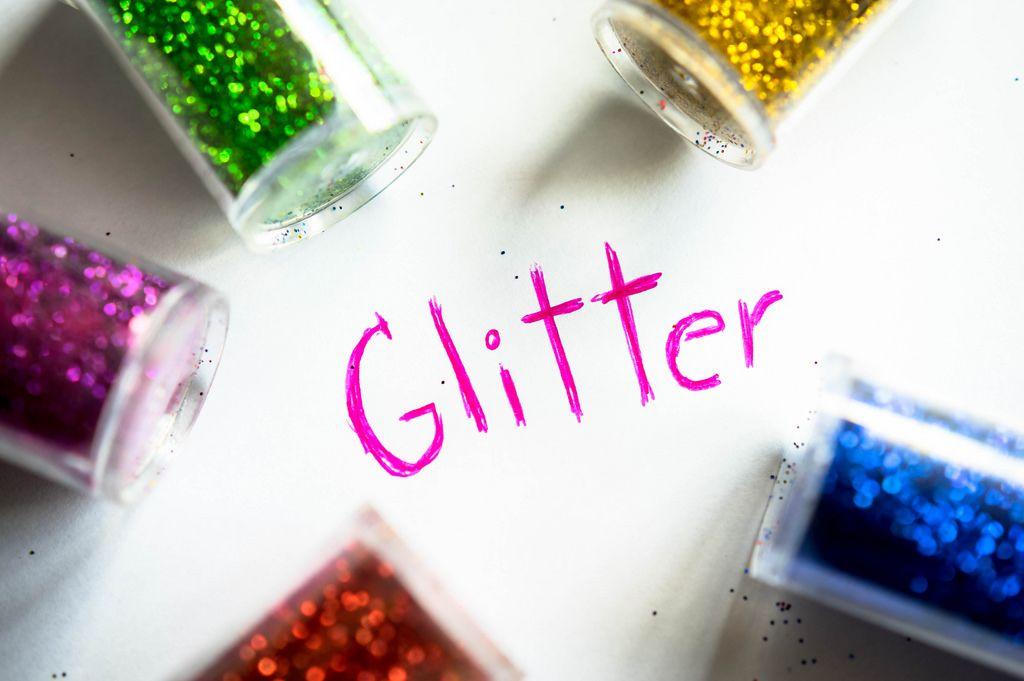 GLITTER word with glitter bottles around it