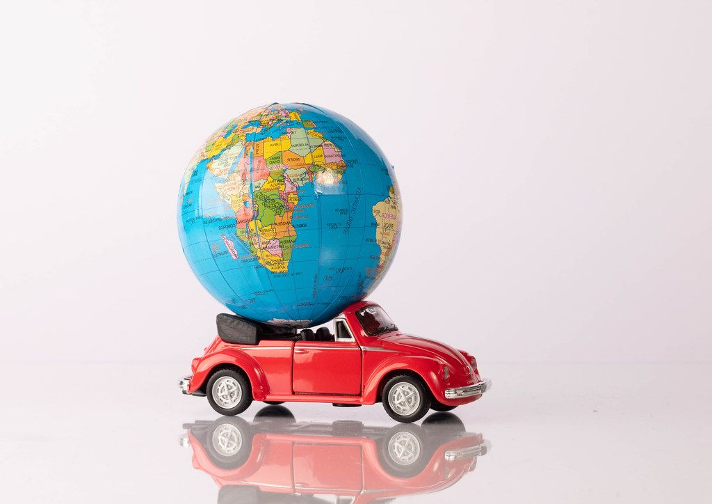 Globe on a red beetle car (Flip 2019)
