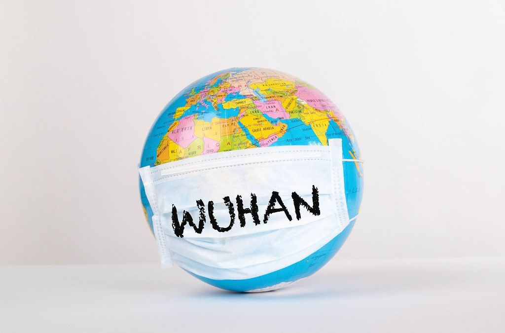 Globe with medical mask and Wuhan text