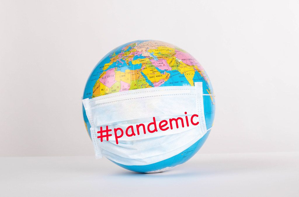 Globe with medical mask on white background with #pandemic text
