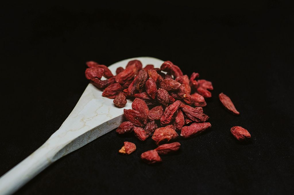 Goji berries on black background