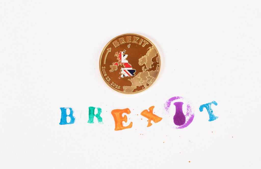 Gold Brexit medal coin with colorful Brexit stamp text