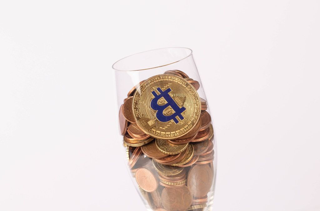 Golden Bitcoin and coins in champagne glass (Flip 2019)