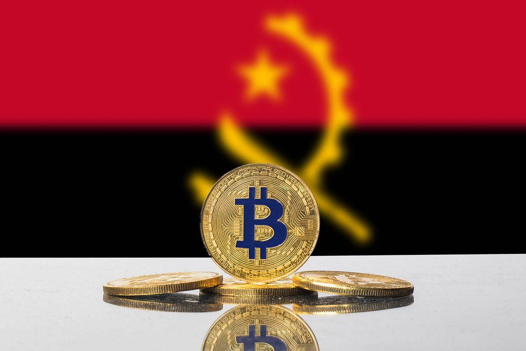 Golden Bitcoin and flag of Angola