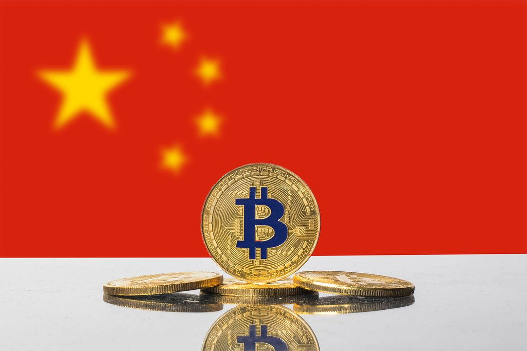 Golden Bitcoin and flag of China
