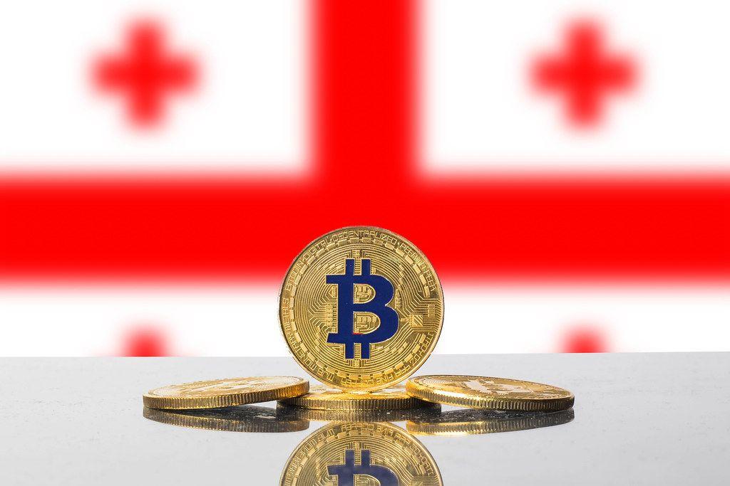Golden Bitcoin and flag of Georgia