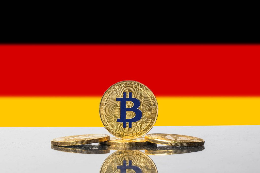 Golden Bitcoin and flag of Germany