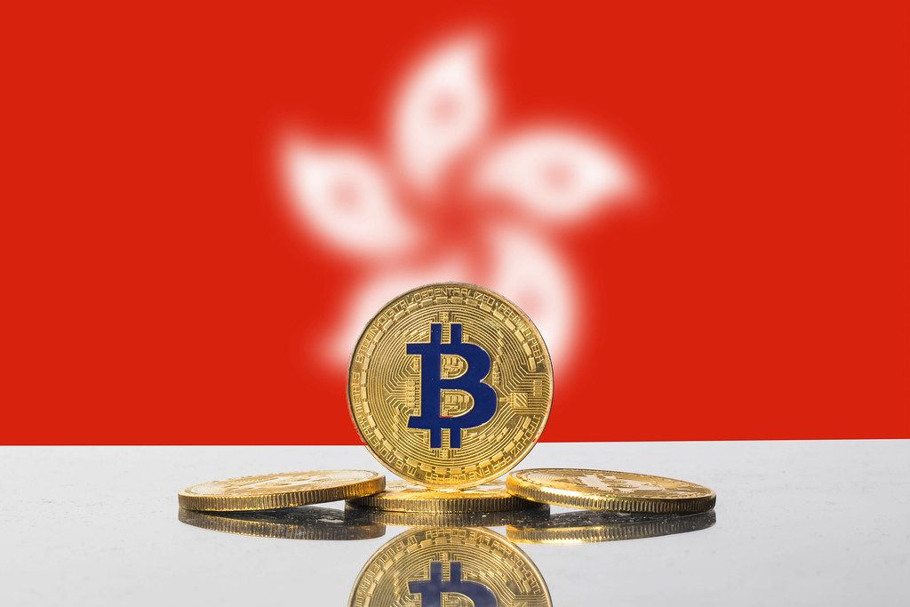 Golden Bitcoin and flag of Hong Kong