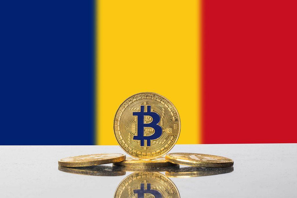 Golden Bitcoin and flag of Romania