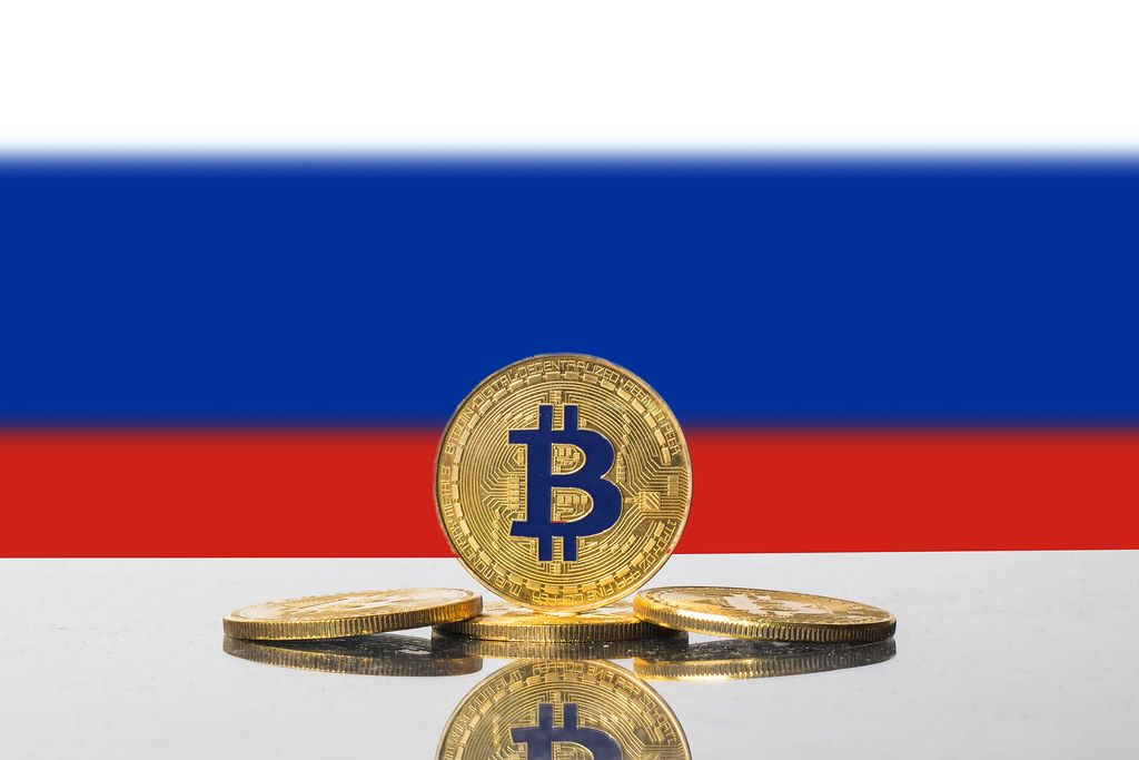 Golden Bitcoin and flag of Russia