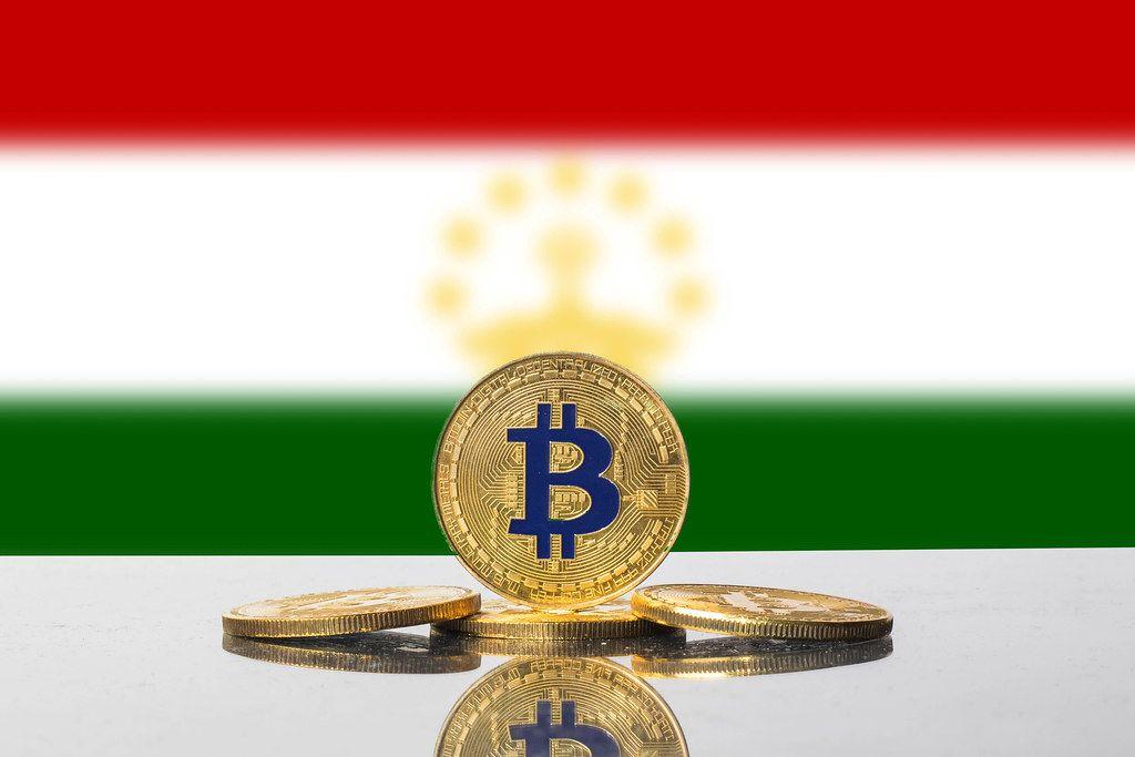 Golden Bitcoin and flag of Tajikistan