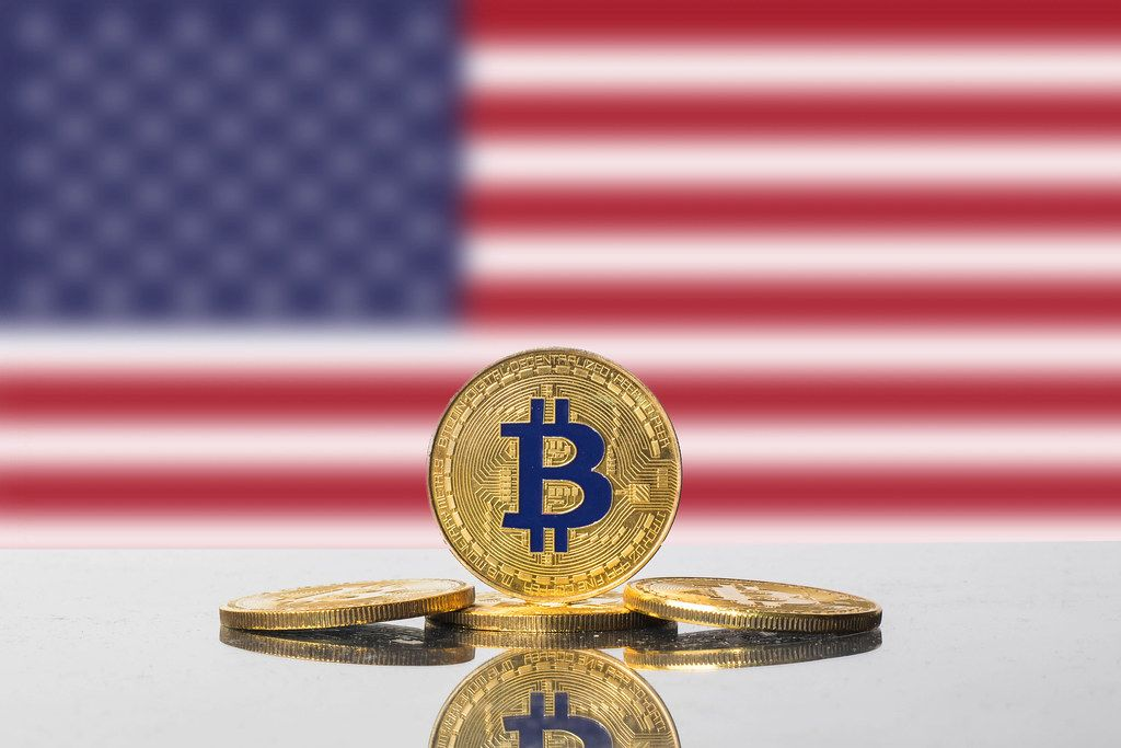 Golden Bitcoin and flag of United States