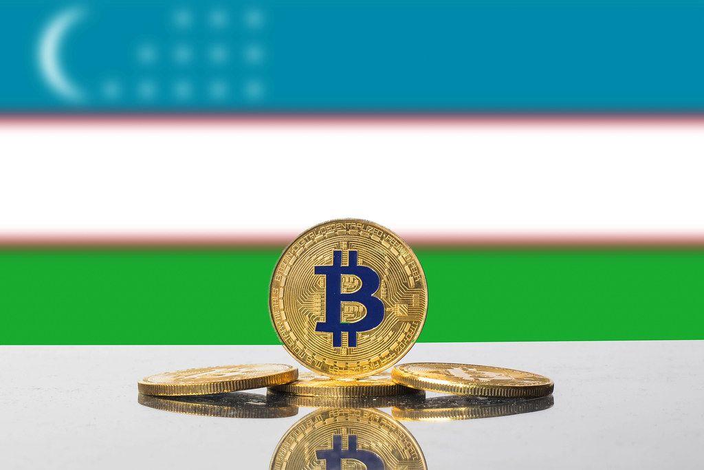 Golden Bitcoin and flag of Uzbekistan