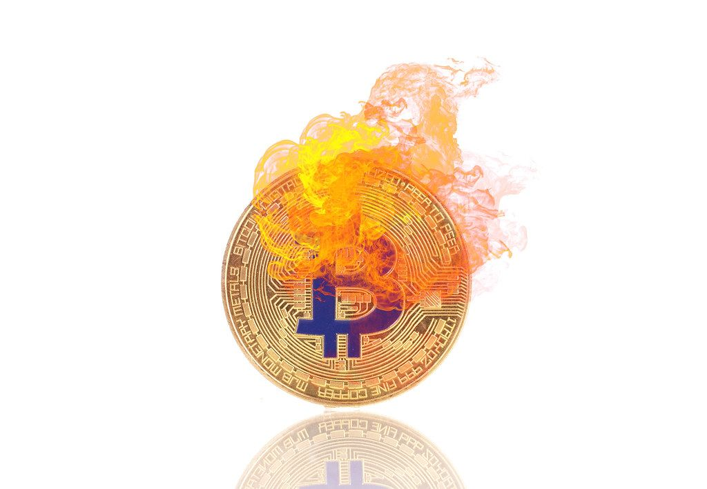 Golden Bitcoin in fire