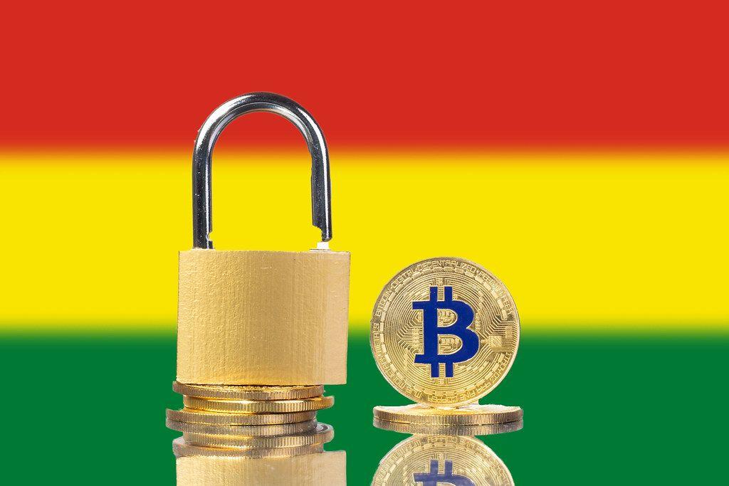 Golden Bitcoin, padlock and flag of Bolivia
