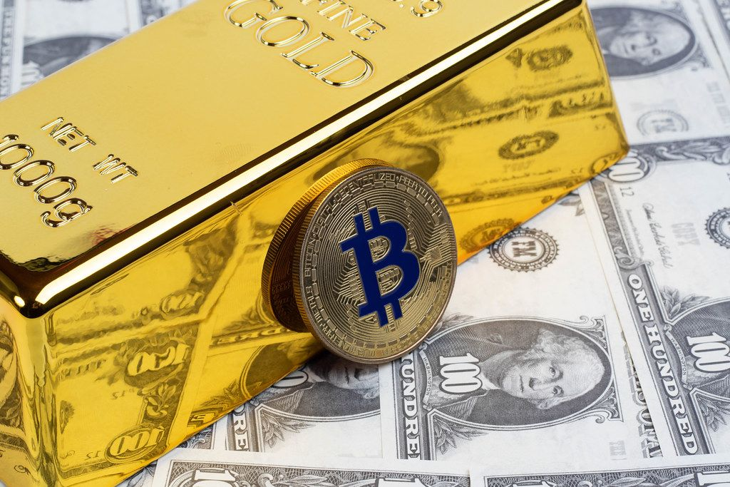 Golden Bitcoin with gold bar and money