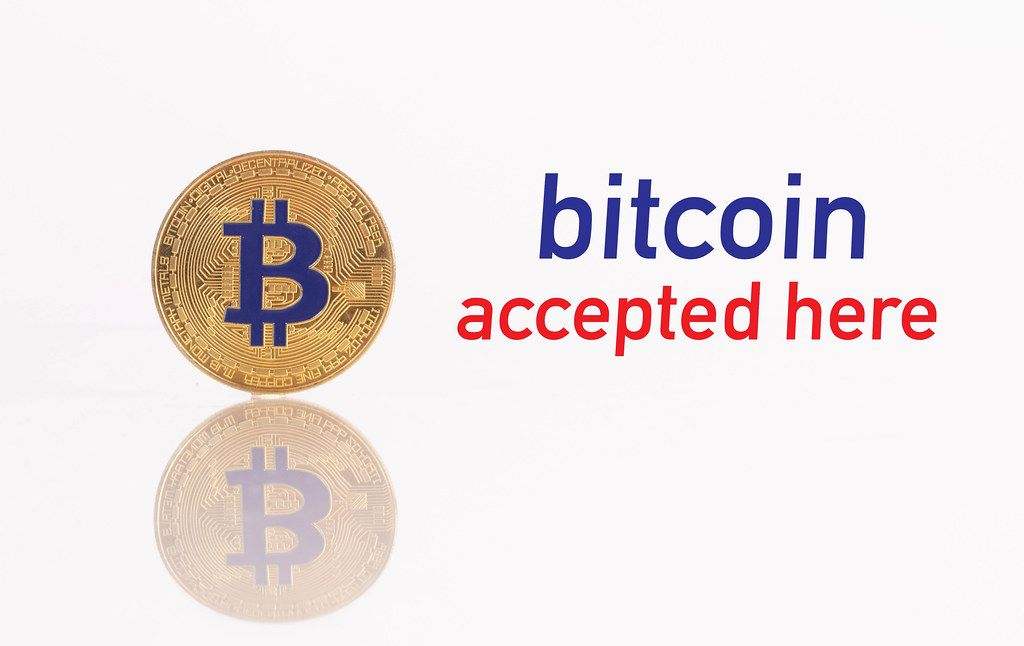 Golden Bitcoin with text Bitcoin accepted here