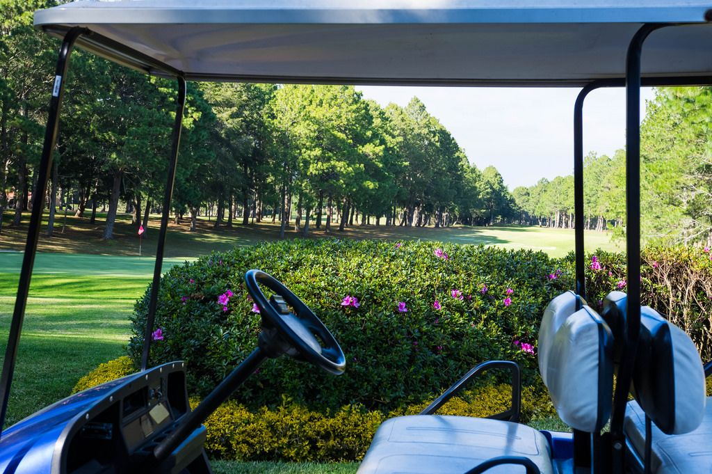 Golf cart in front of golf course