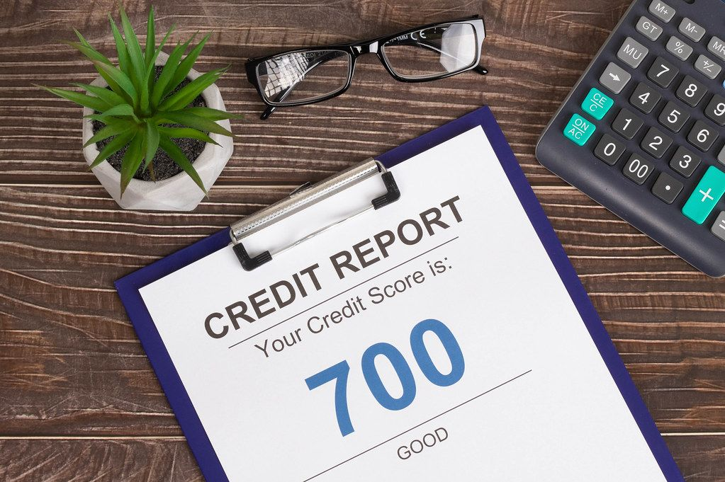 Good credit score report of 700 on wooden desk