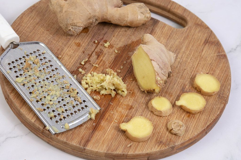 Grated Ginger on the wooden board