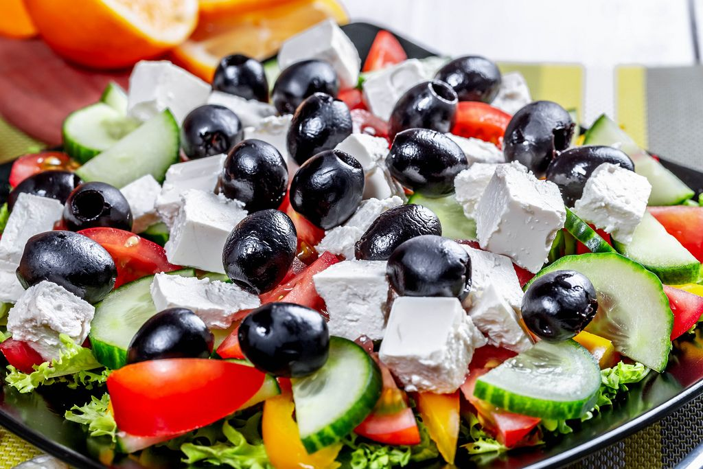 Greek salad with fresh vegetables, feta cheese and black olives. Top view (Flip 2019) (Flip 2019) Flip 2019