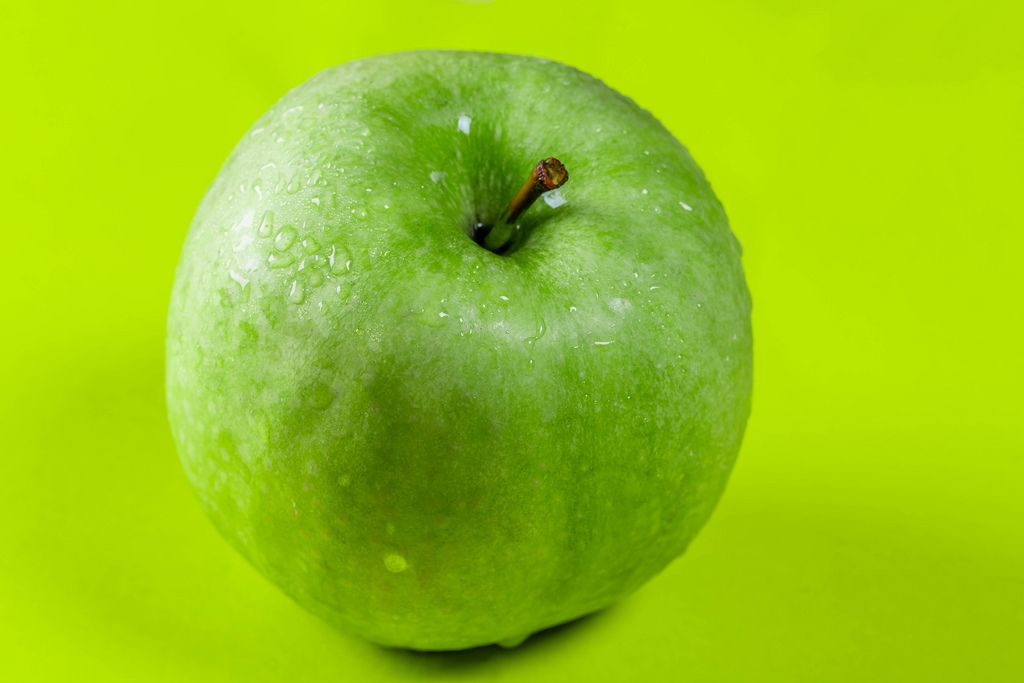 Green Apple on green background