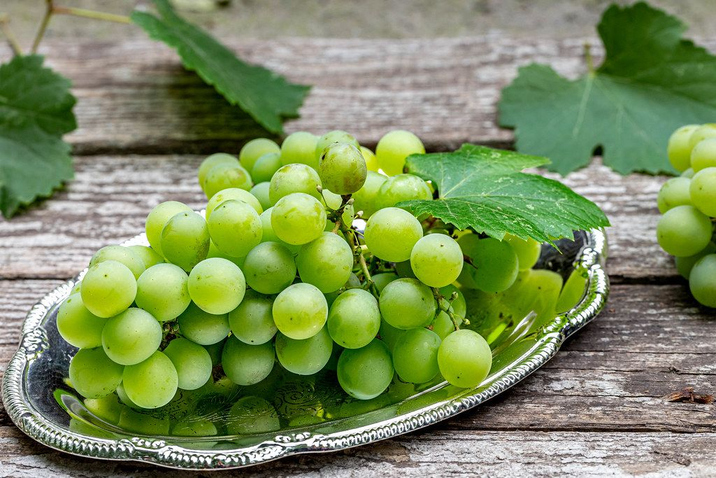 Green bunch of grape on gray wooden background (Flip 2019)