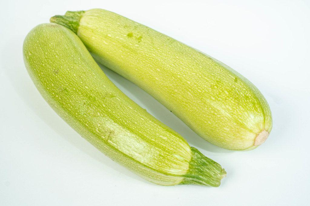 Green Zucchini above white background (Flip 2019)