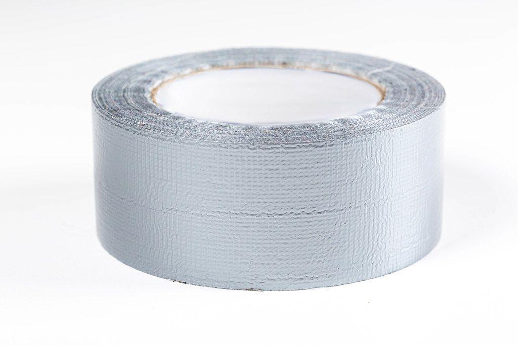 Grey adhesive tape on white background