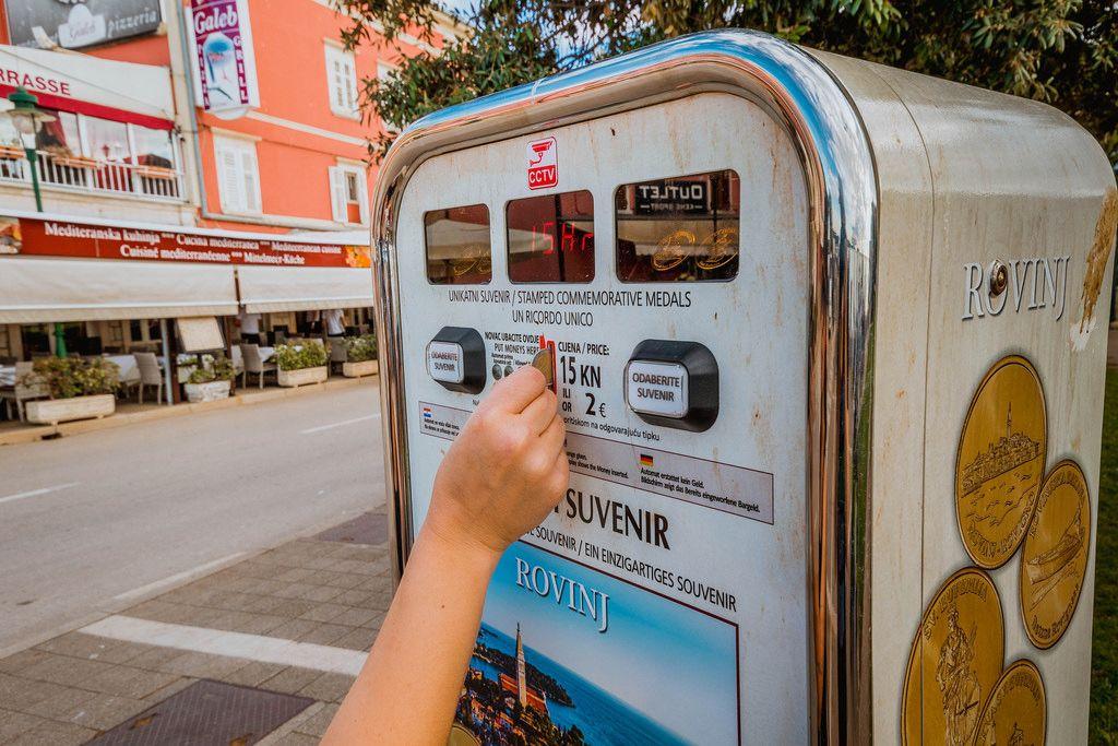 Gril buying souvenir at street in Rovinj