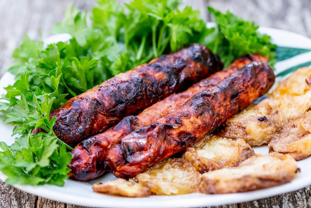 Grilled sausage with fresh parsley and fried courgettes