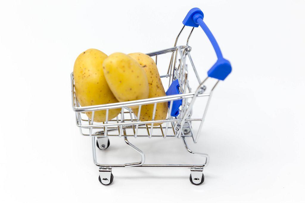 Grocery shopping - potatoes in a shopping cart