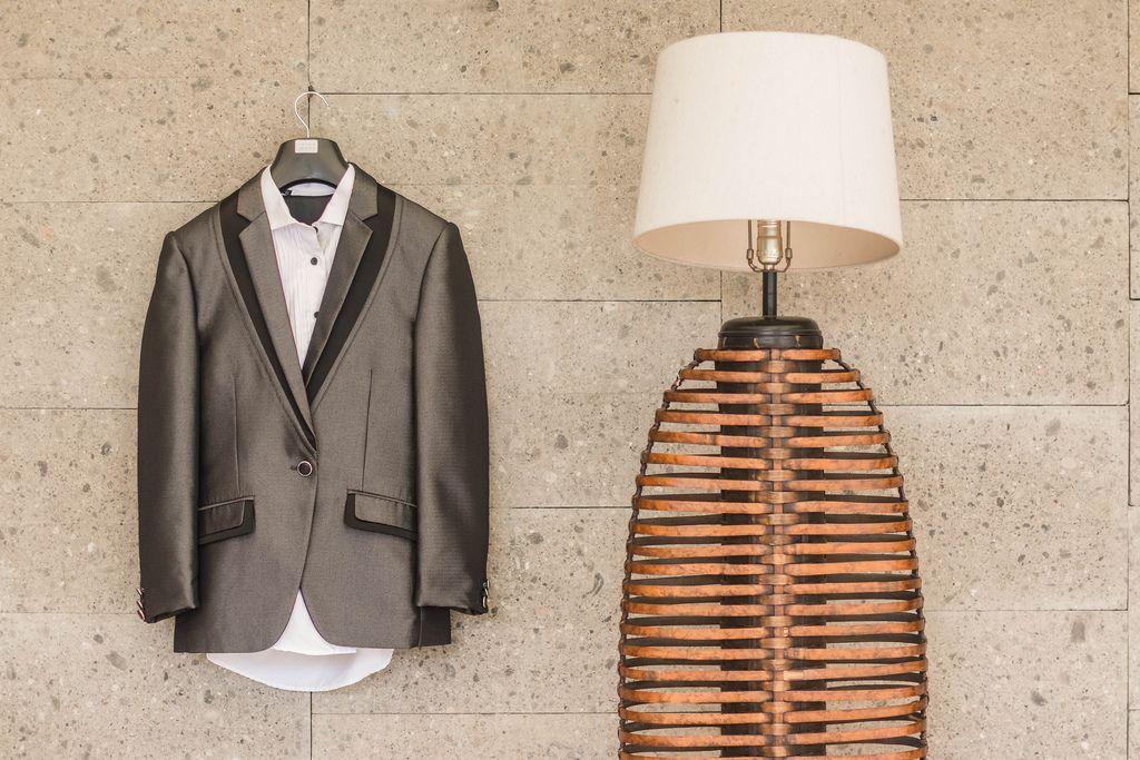 Groom's Suit hanging next to a lamp (Flip 2019) (Flip 2019) Flip 2019
