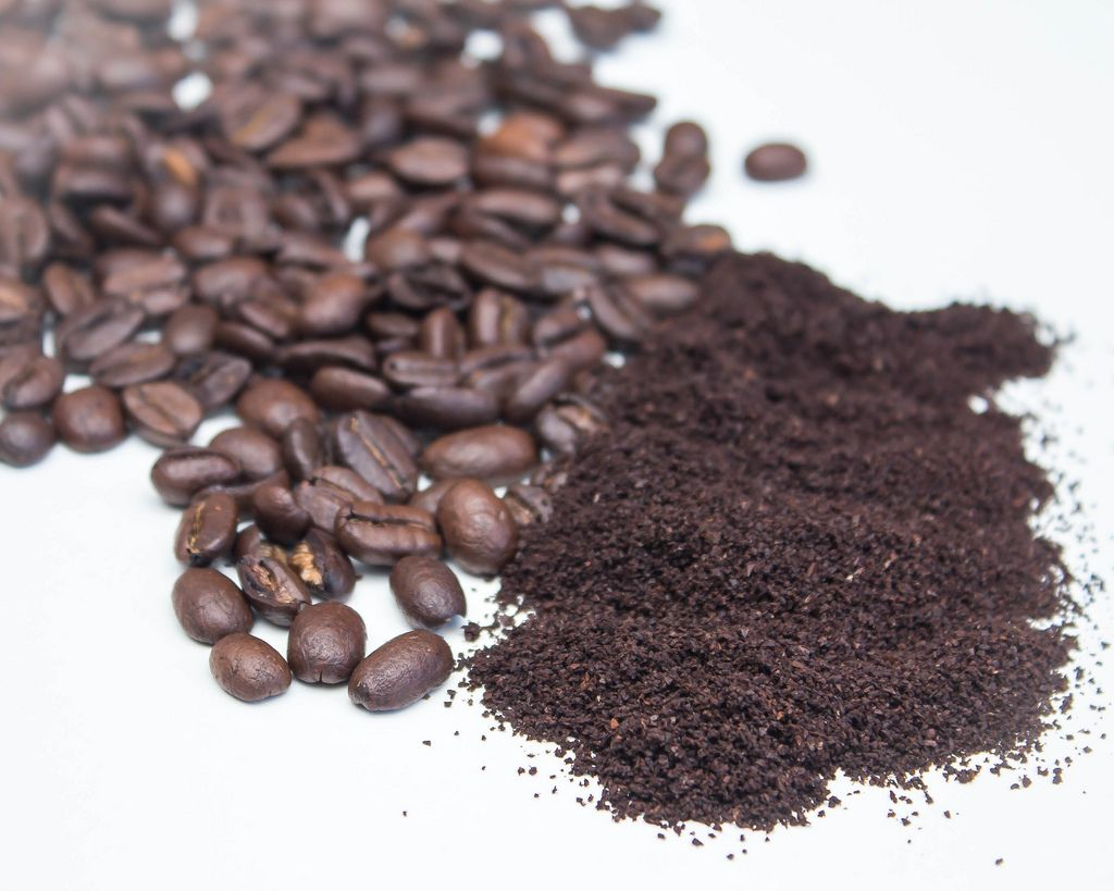 Ground Coffee and Bean on a White Background  (Flip 2019) (Flip 2019) Flip 2019