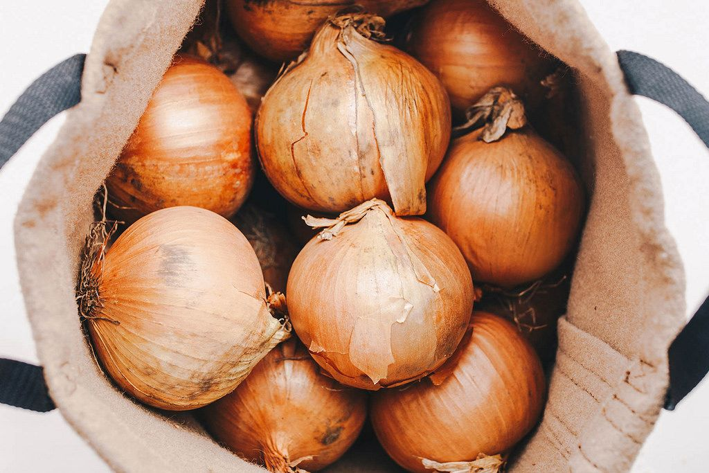 Group of onions in a sack. Top view