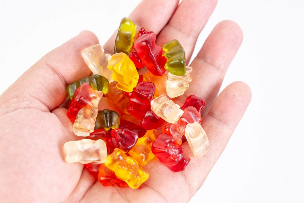 Gummy Bears in the hand above white background