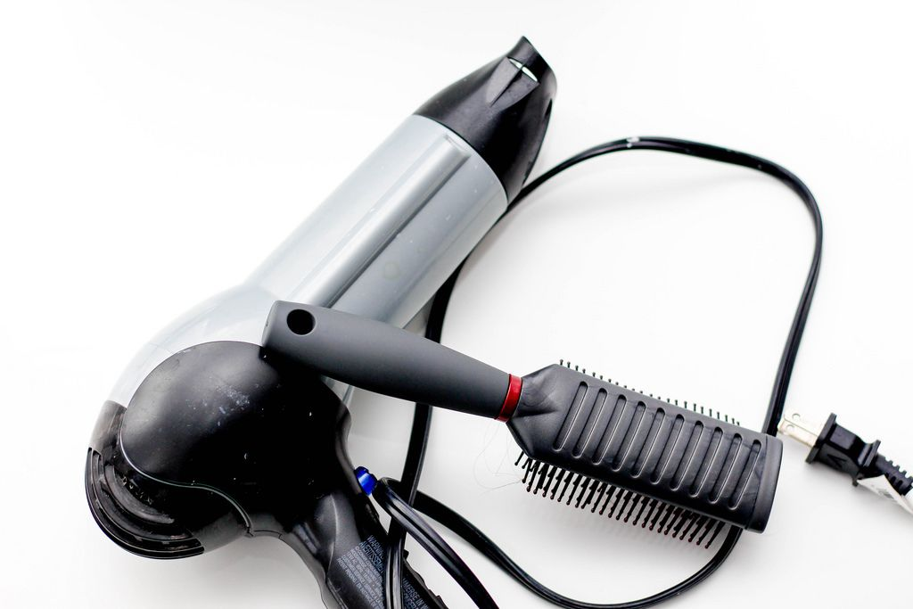 Hair Dryer and Brush on a White Background