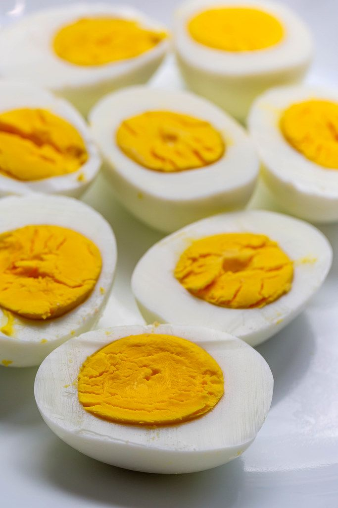 Halves of boiled eggs on a white plate